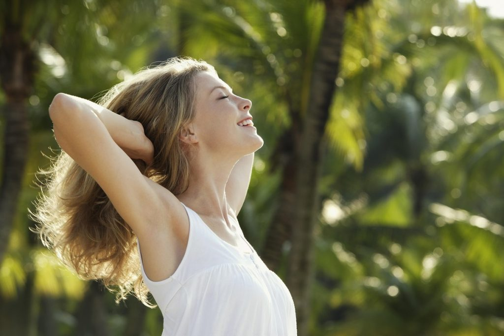 Woman smiling, happy, and free. Emotional freedom technique, EFT Tapping Scripts