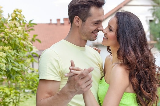 A Happy Man Cherishing A Happy Woman In Passionate Romance, Love And The Law of Attraction